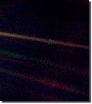 Seen from 6.4 billion kilometres away, Earth is a dot obscured in a beam of scattered sunlight (pinpointed by artificial blue circle).